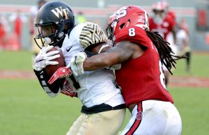Oct 1, 2016; Raleigh, NC, USA;  Wake Forest Deamon Deacons receiver Tabari Hines (1) is tackled by North Carolina State Wolfpack defensive back Dravious Wright (8)during the second half at Carter Finley Stadium. The Wolfpack won 33-16. Mandatory Credit: Rob Kinnan-USA TODAY Sports
